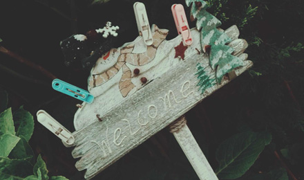 Garden sign with clothespins