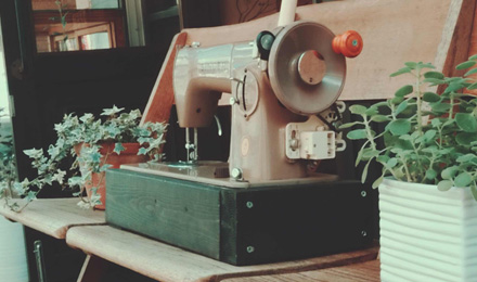Sewing machine on wooden bench