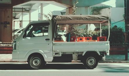 Mini truck carrying beer bottles