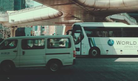 Van and bus passing through