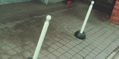 White traffic poles